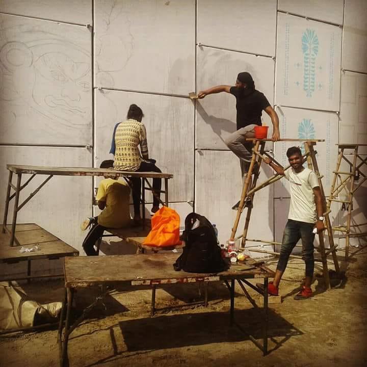 Kamaldeep Singh painting on a wall - Student of Fine Arts at LPU